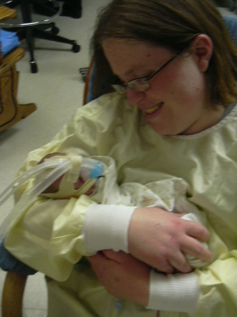 Me holding Daniel for the first time in April 2009.
