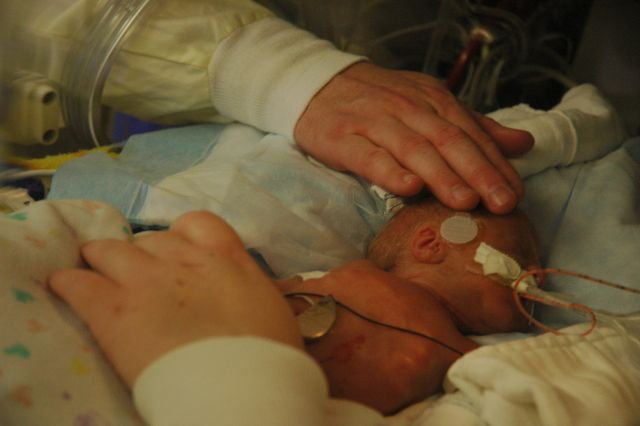 Baptizing Daniel at 4 days old.