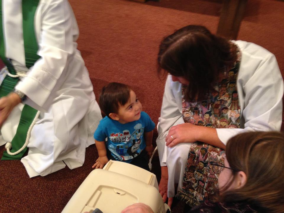 Edda being blessed at church.