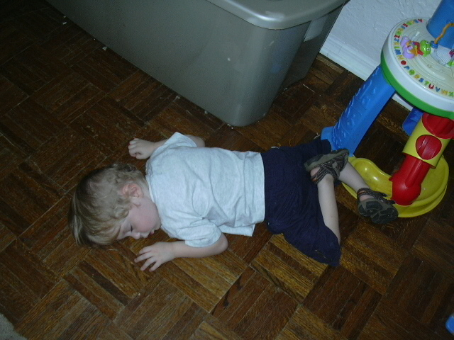 Daniel asleep on the hardwood floor