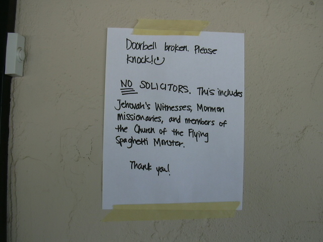The sign by our door.