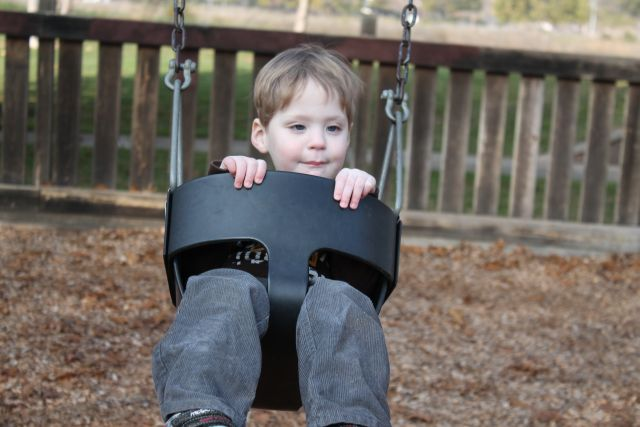 A shot of Daniel in the swing at Miwok Park.