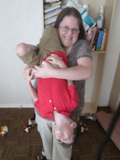 Jen with Daniel upside down