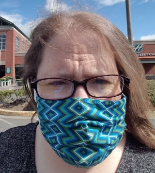 Me with my awesome mask... because I actually care about the health of the people around me, unlike you twits.